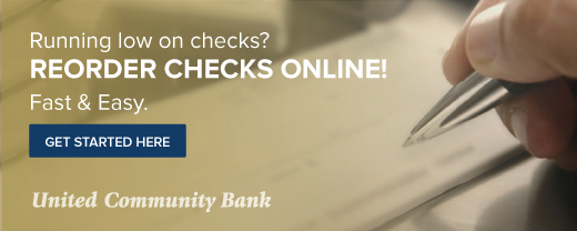 Running low on checks? Reorder checks online! Fast & Easy. Get started here. Image of hand holding a pen writing a check.
