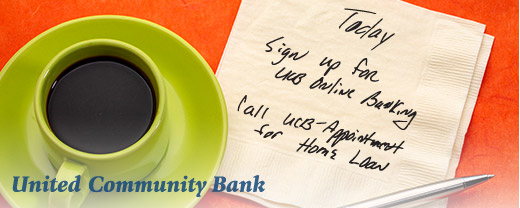 Cup of coffee with a napkin note to sign up for online banking.